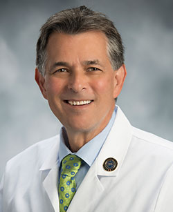 A headshot of a doctor