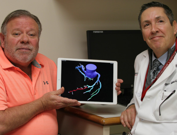A patient and a doctor showing heartflow app on a tablet